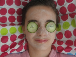 girls face with cucumber on eyes,