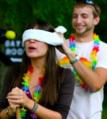 man blindfolding woman to hide a surprise